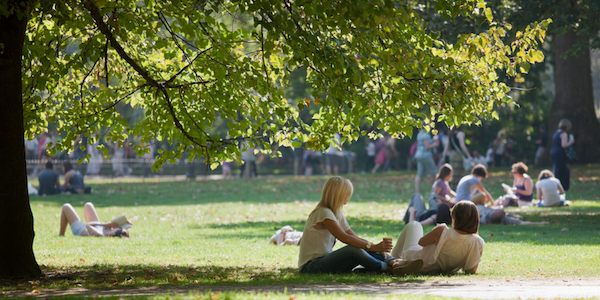 People sitting outside in park
